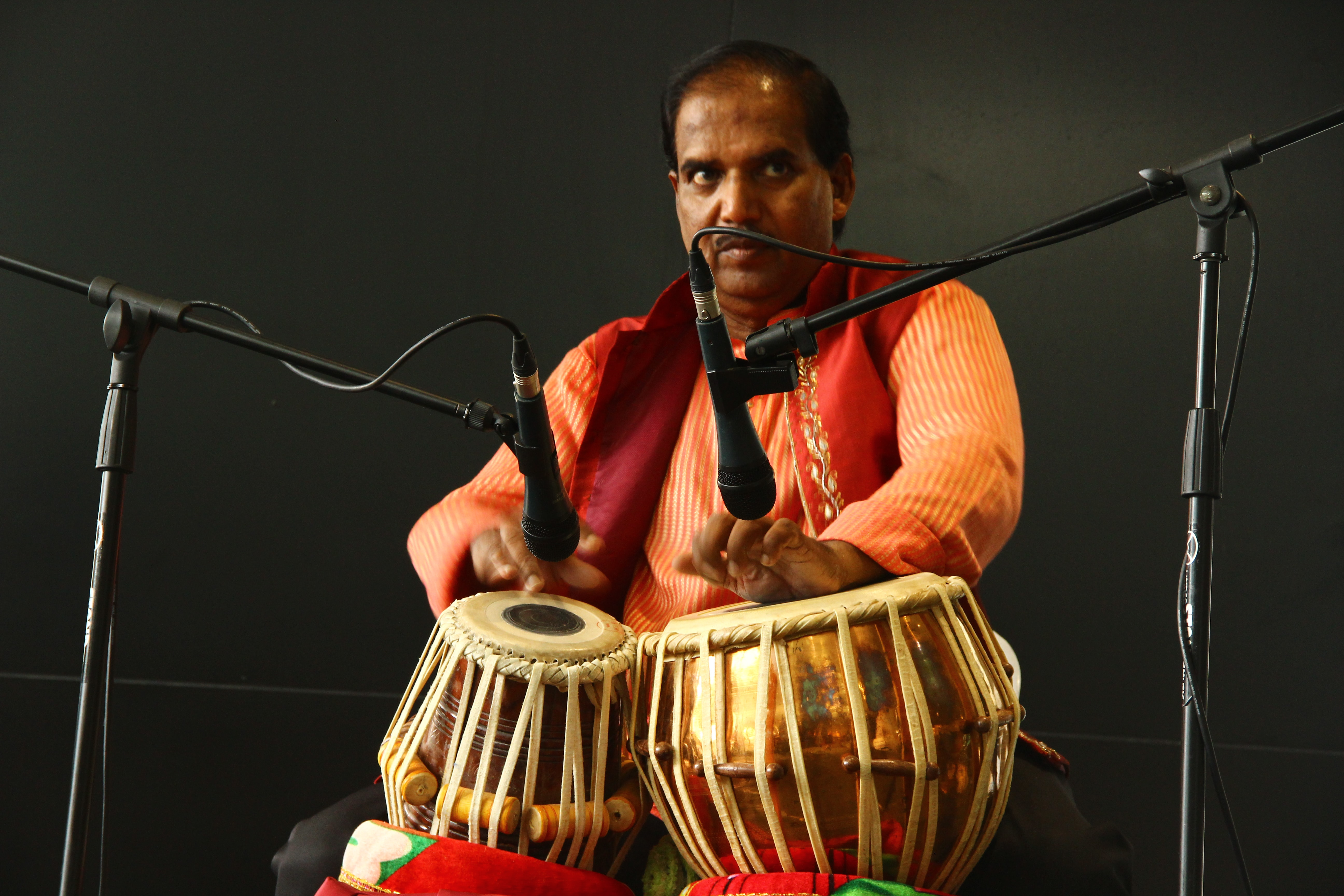 man playing a drum instrument