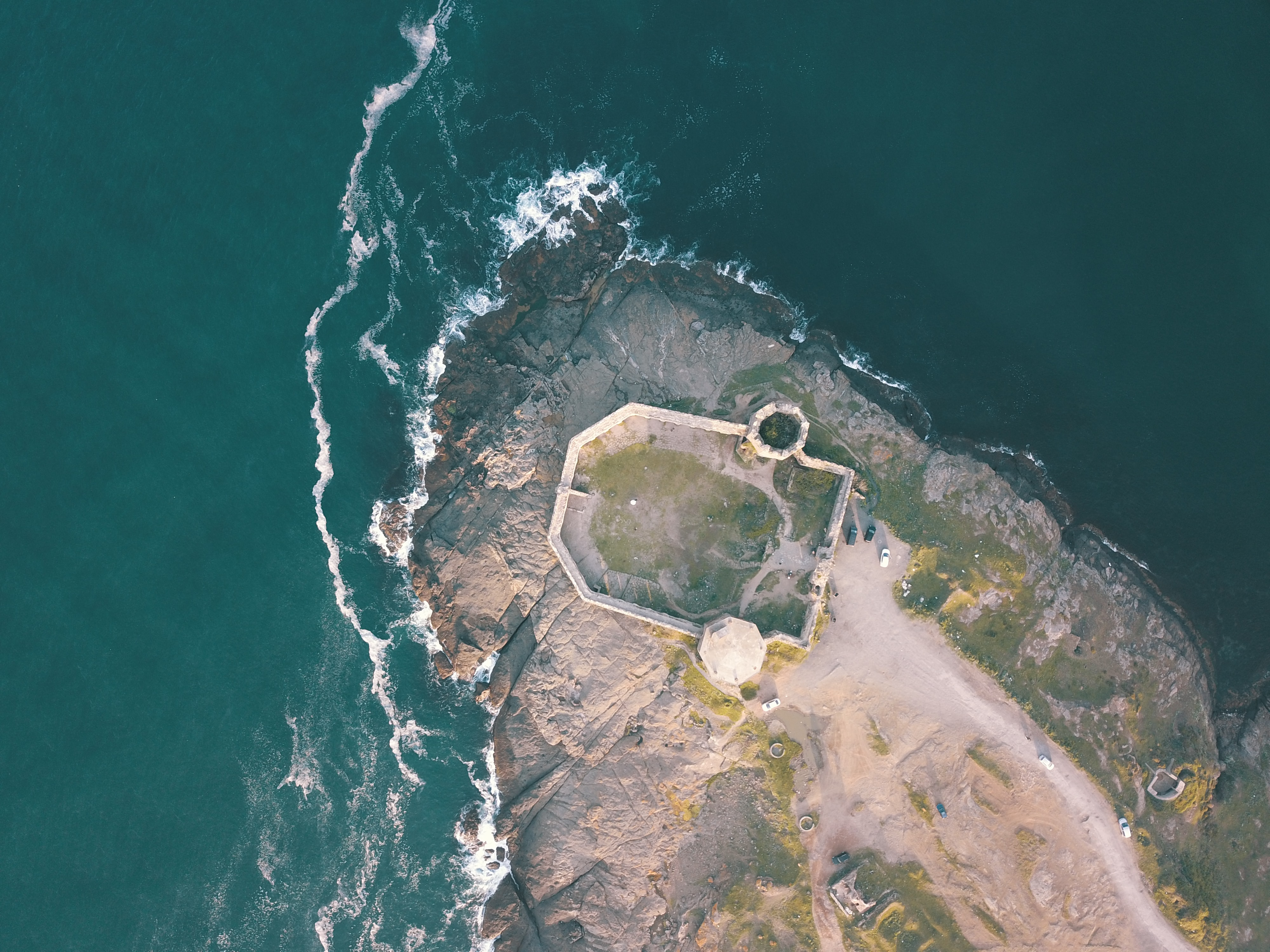 aerial view photography of island beside sea at daytime