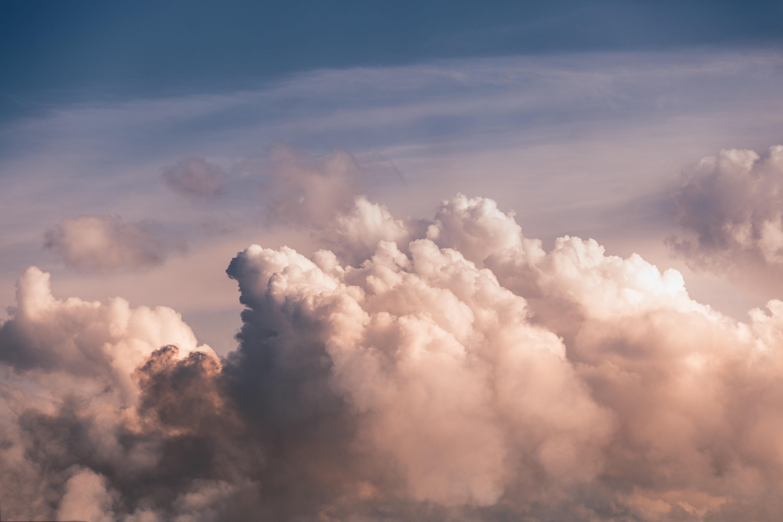 white clouds under blue skies