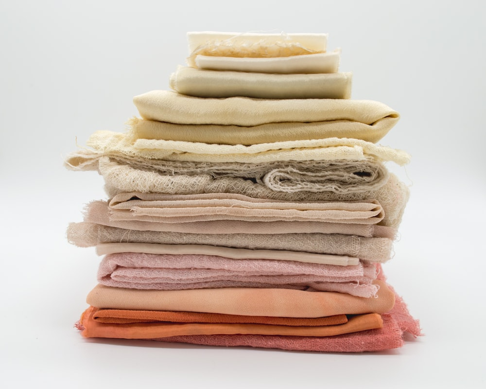 pile of cloth on white surface