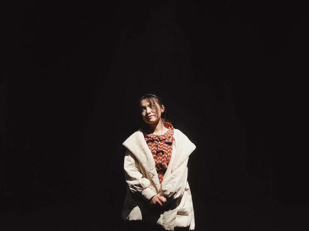 woman wearing white jacket