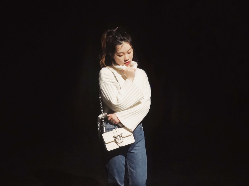 woman wearing white sweate