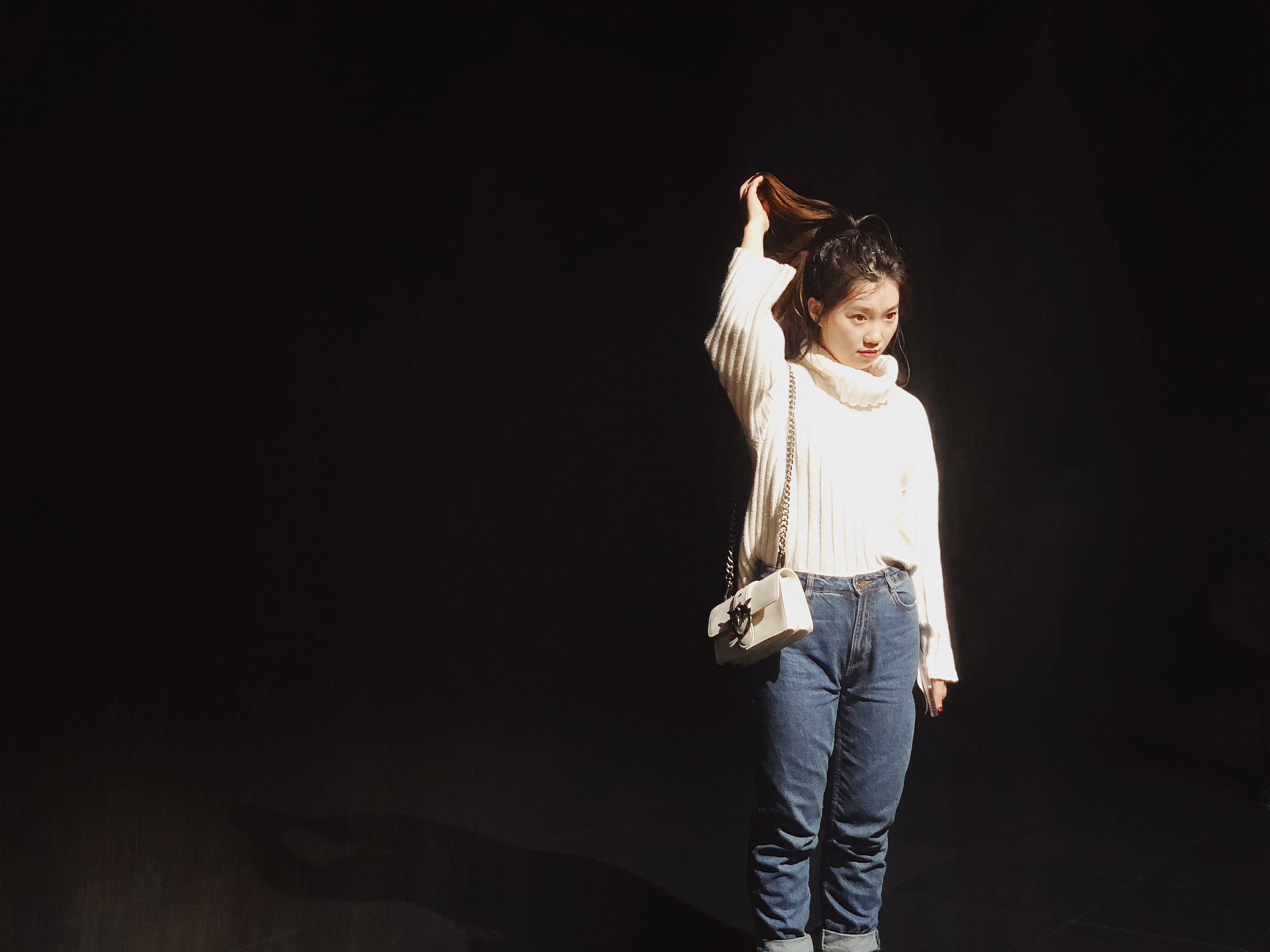 woman standing while holding her hair