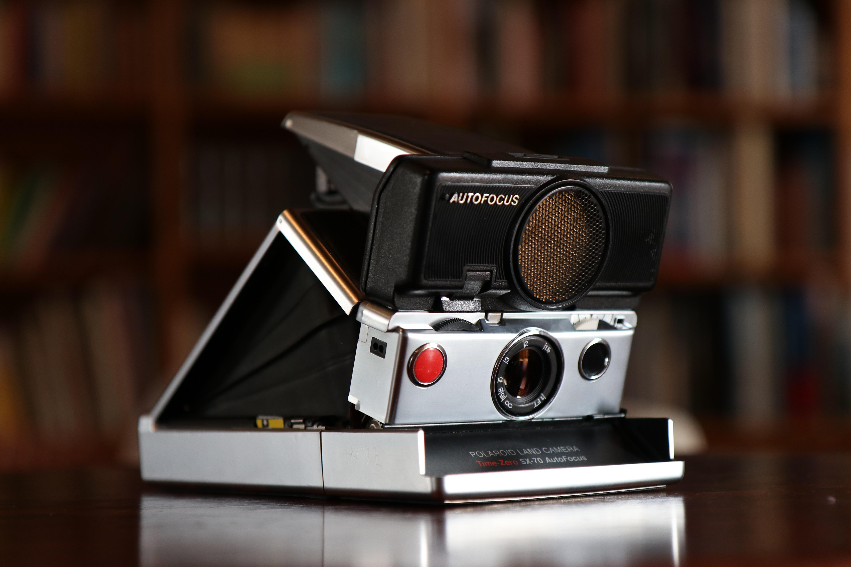 black and gray Polaroid camera