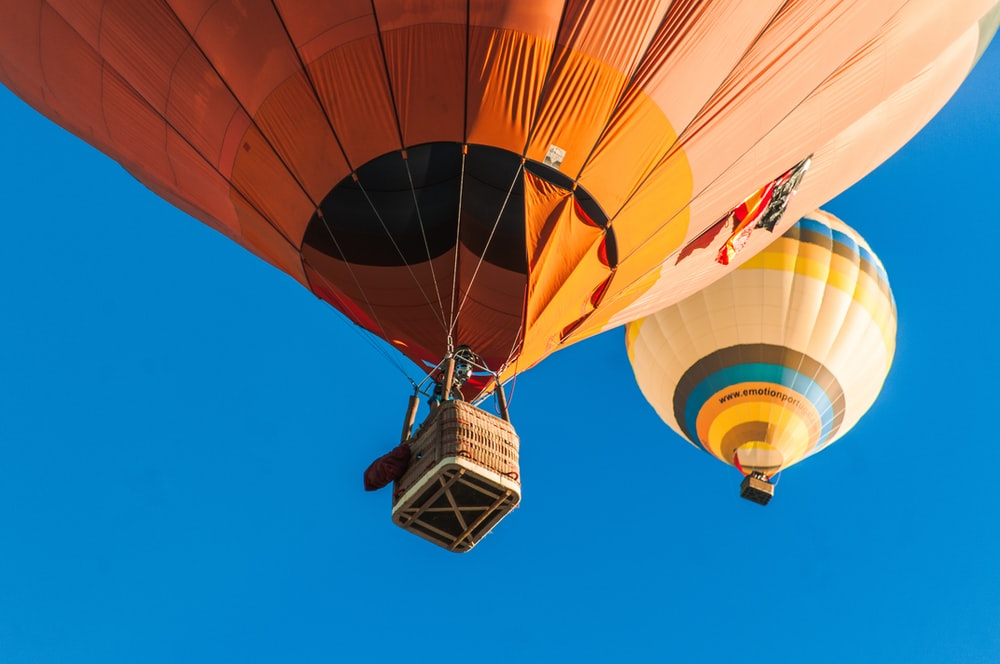 two hot air balloons in the sky during daytime