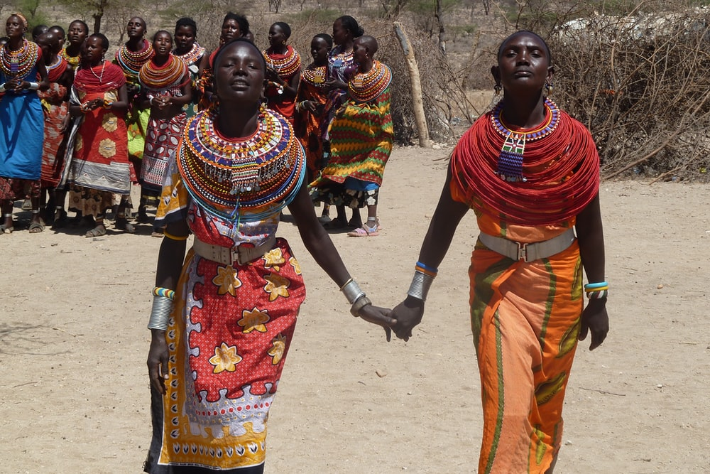 two women holding hands each other