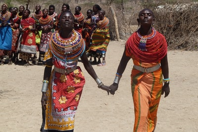 two women holding hands each other kenya zoom background