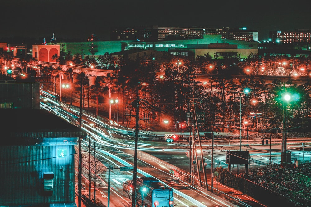 time-lapse photo of lighted buildings at night time