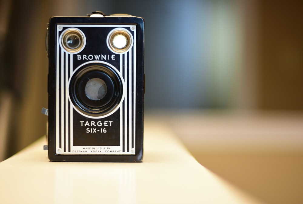 selective focus photography of white and black Brownie Target SIX-16 camera