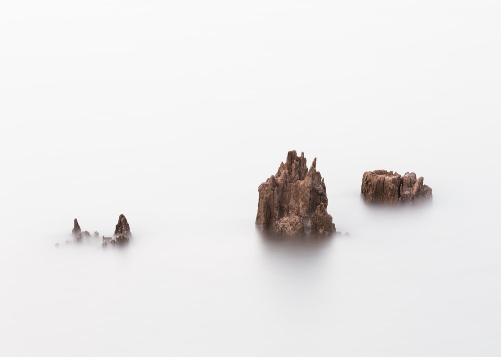 rock formation on body of water