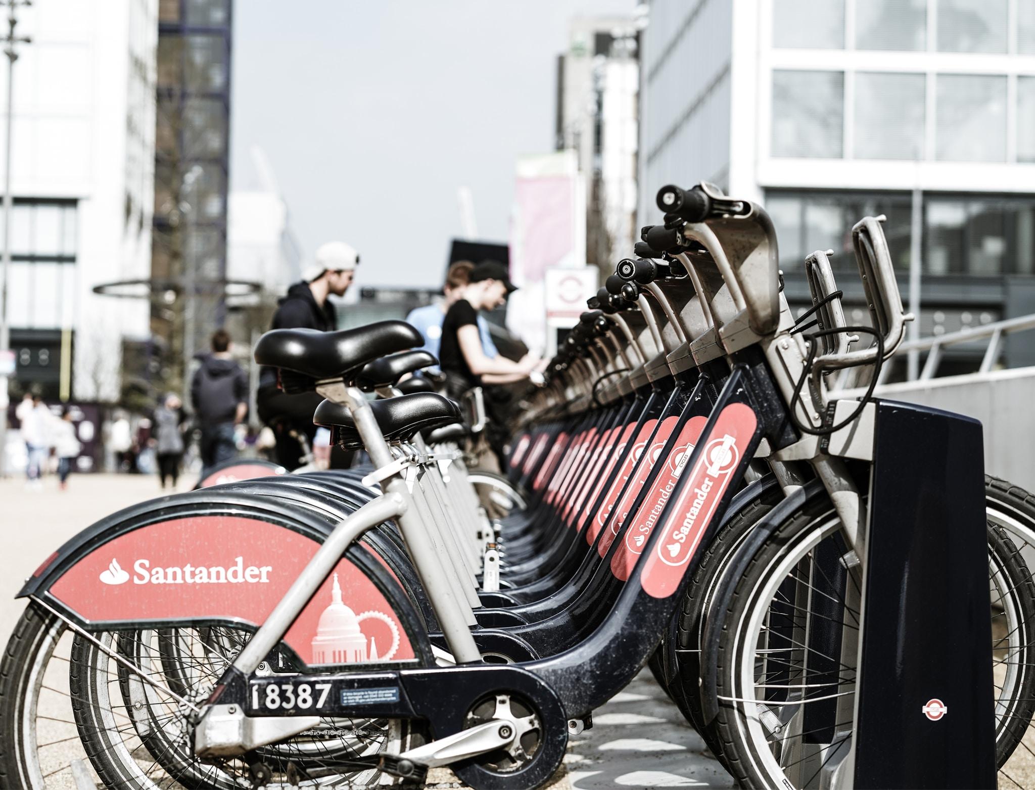 black Santander bicycles parked on bicycle stand