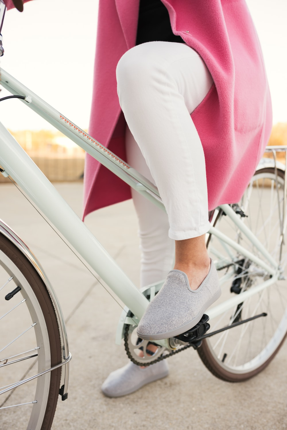 person sitting on white bicycle
