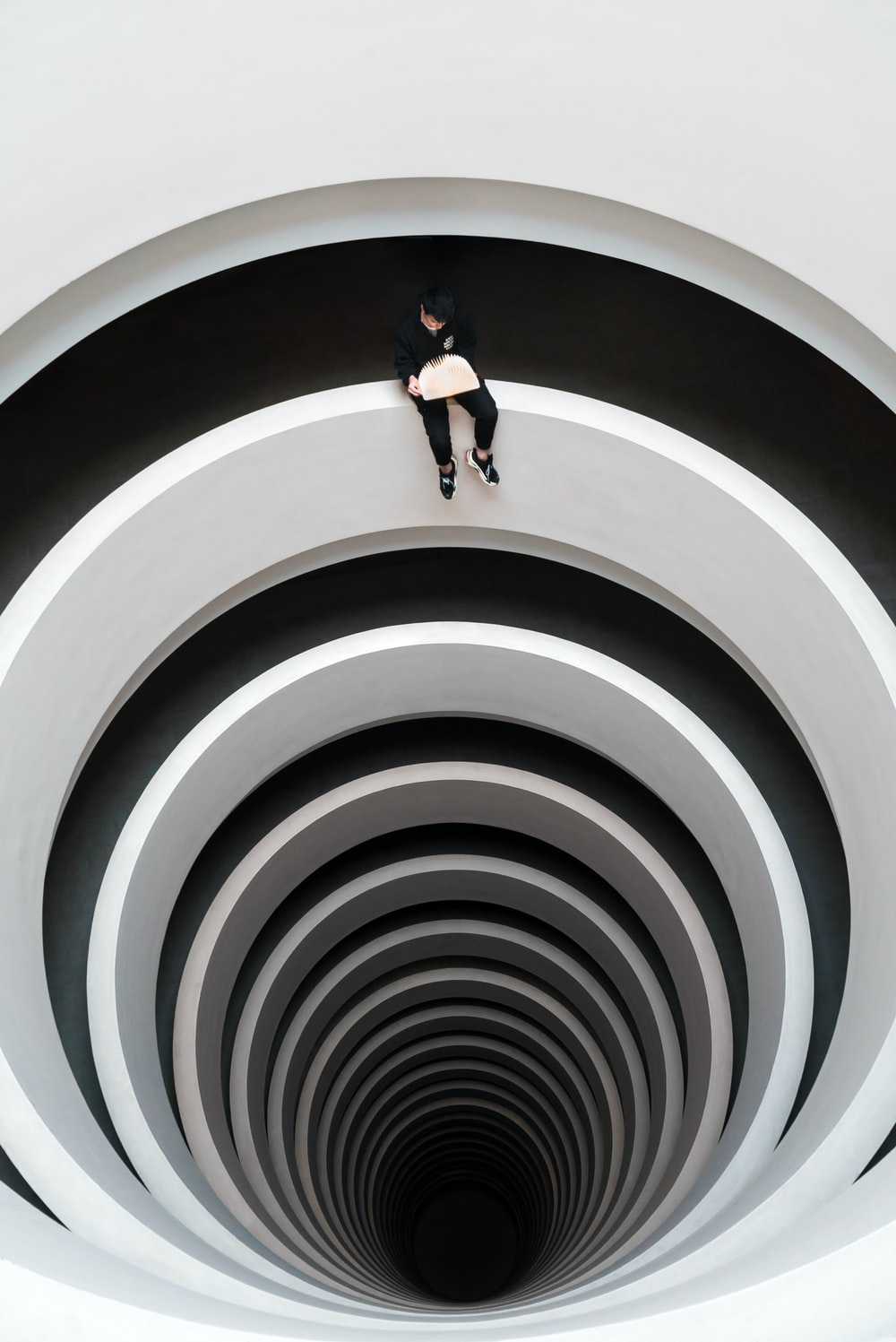 man sitting on deep pit design