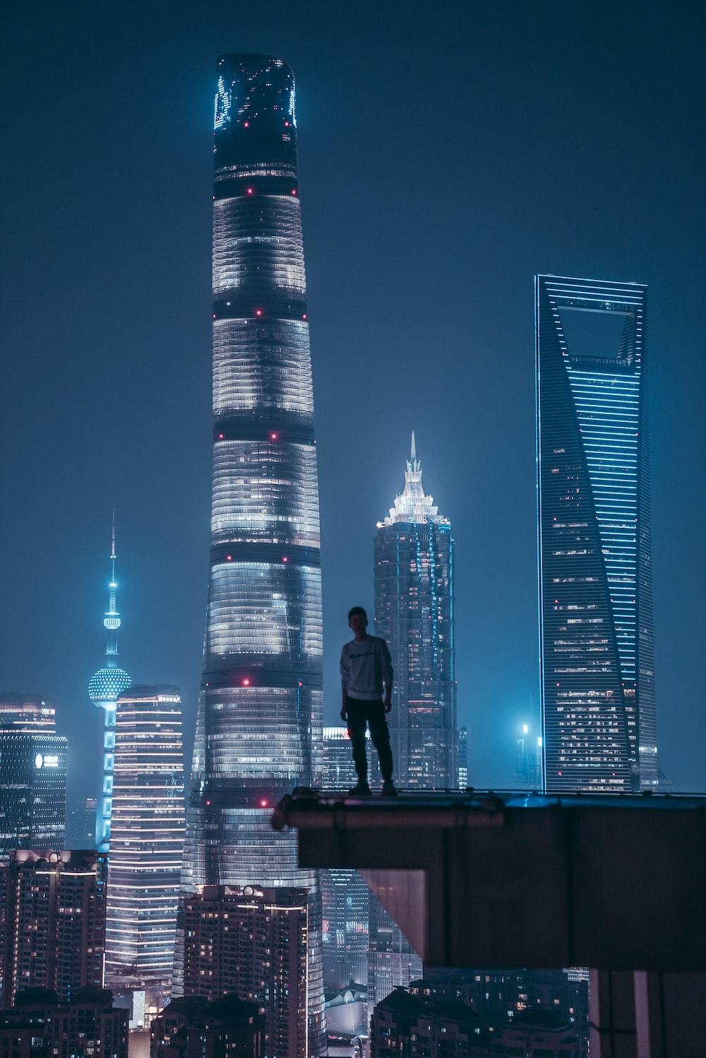 man standing on top of skyscraper
