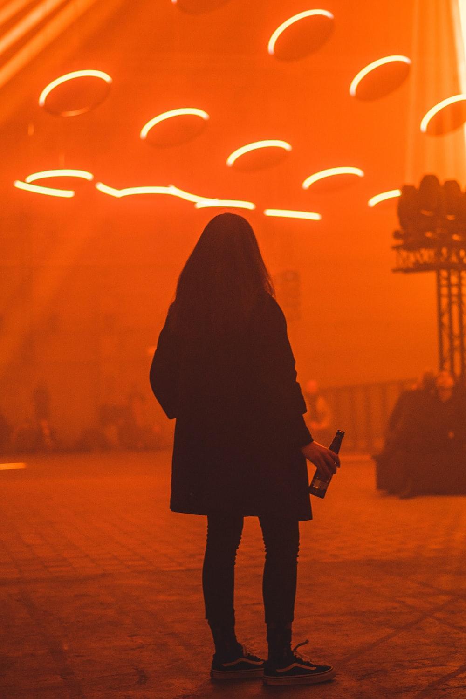 woman holding bottle inside lightning room