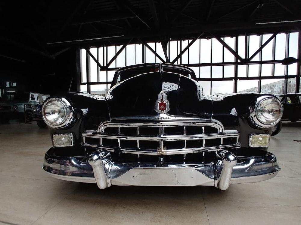 vintage black car parked at the garage