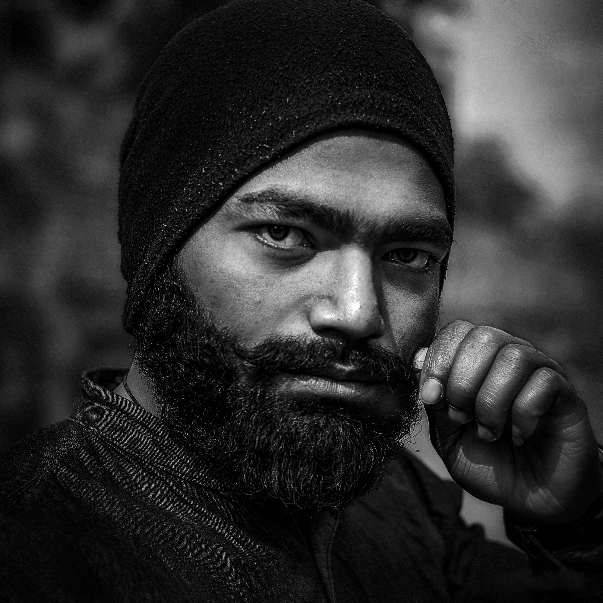 gray scale photography of man wearing hat