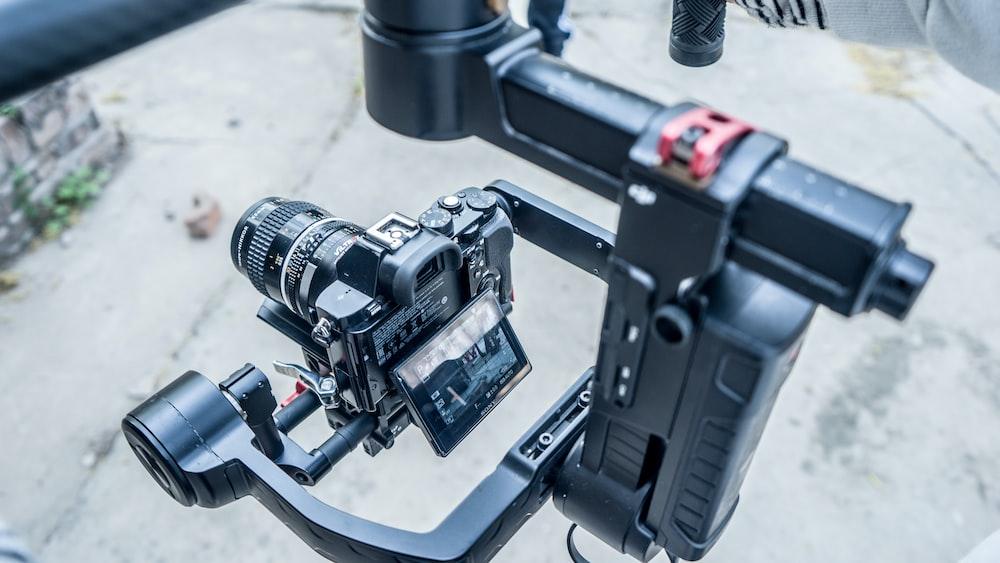 black DSLR camera with black holder