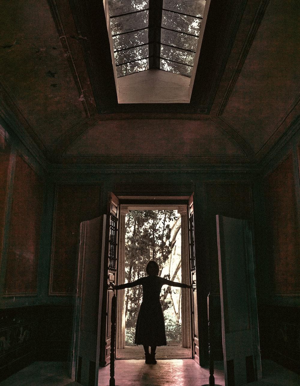 woman standing in front of a door