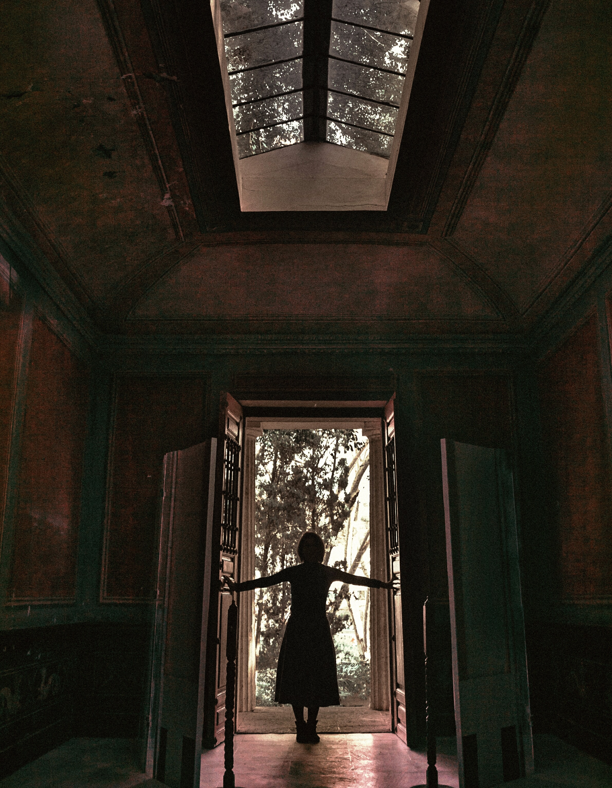 woman standing in front of a door