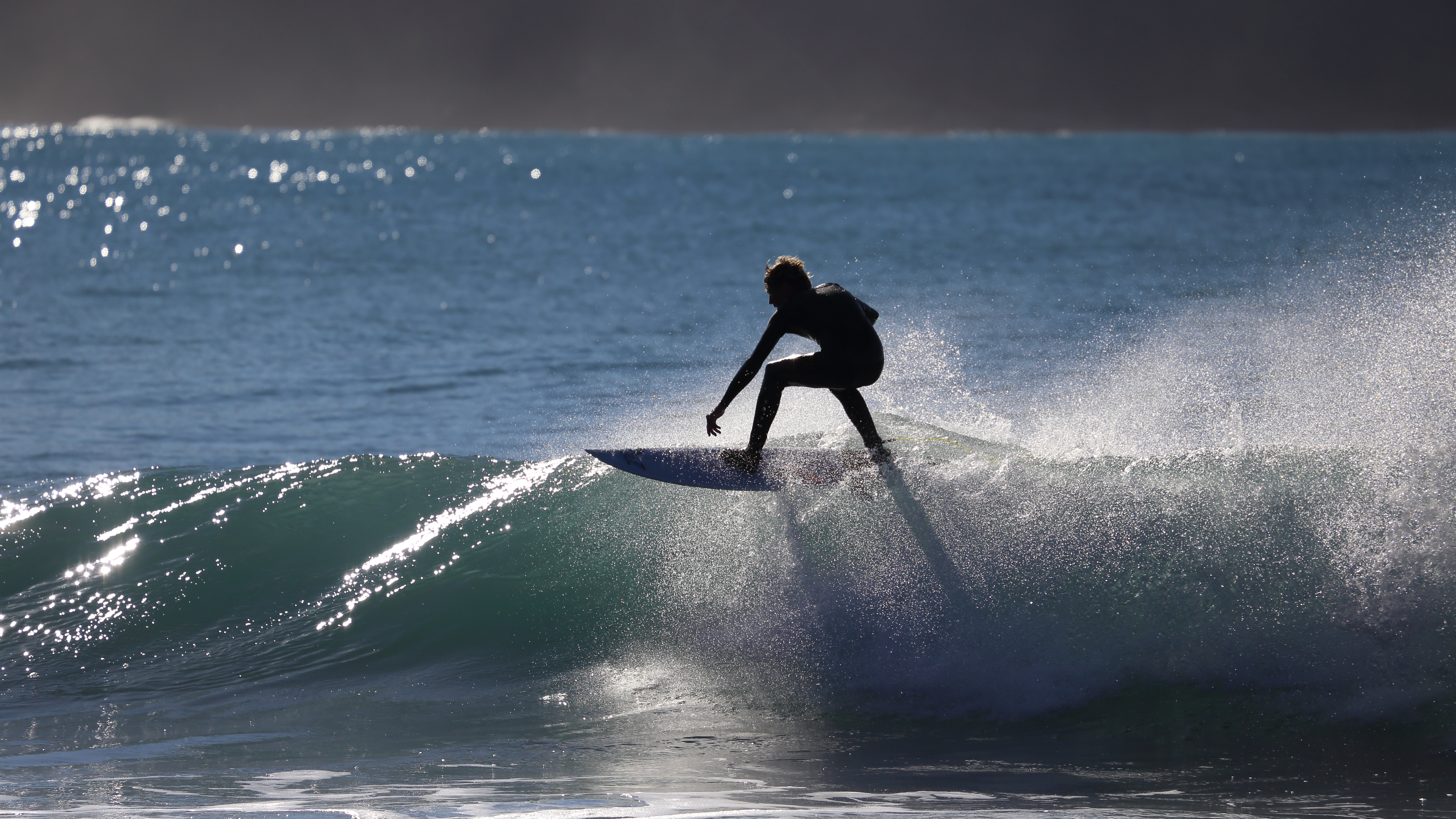 Heading home along the coast of the South Island, some surfers from Raglan where here trying out these breaks and with the early morning sun on the water, too glorious to drive by.