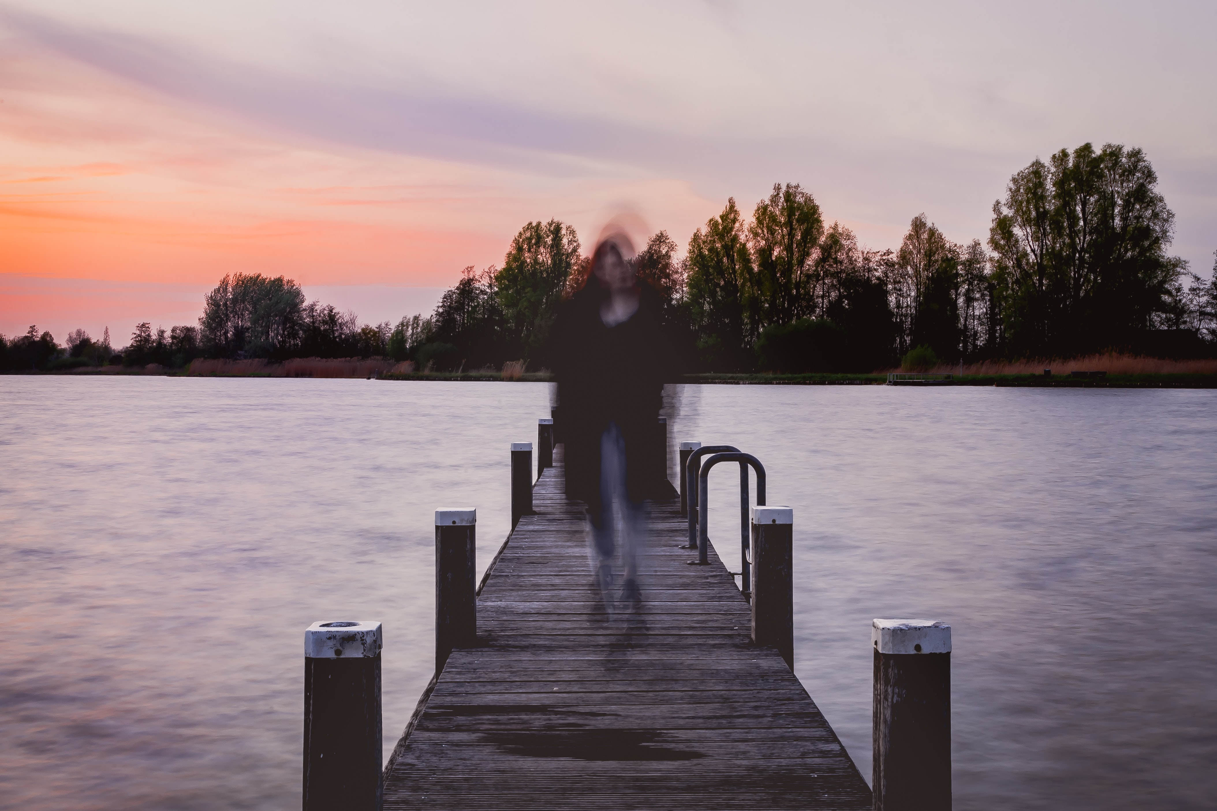 woman standing on sea dock
