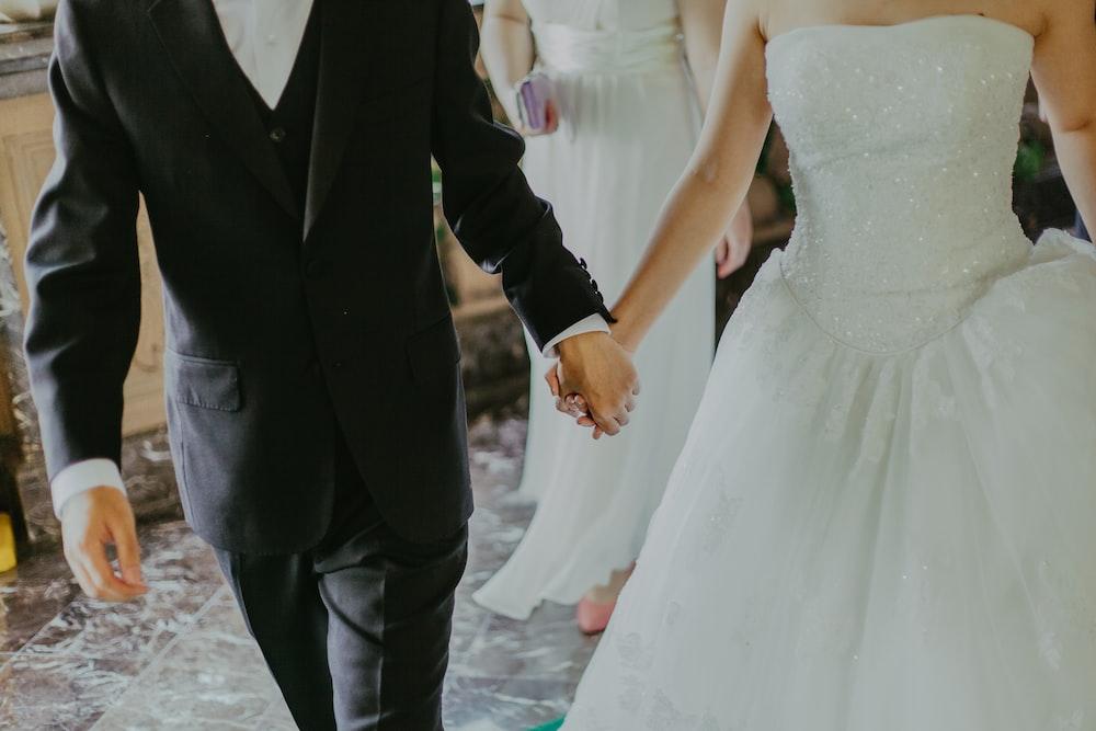 groom and bridge holding hands