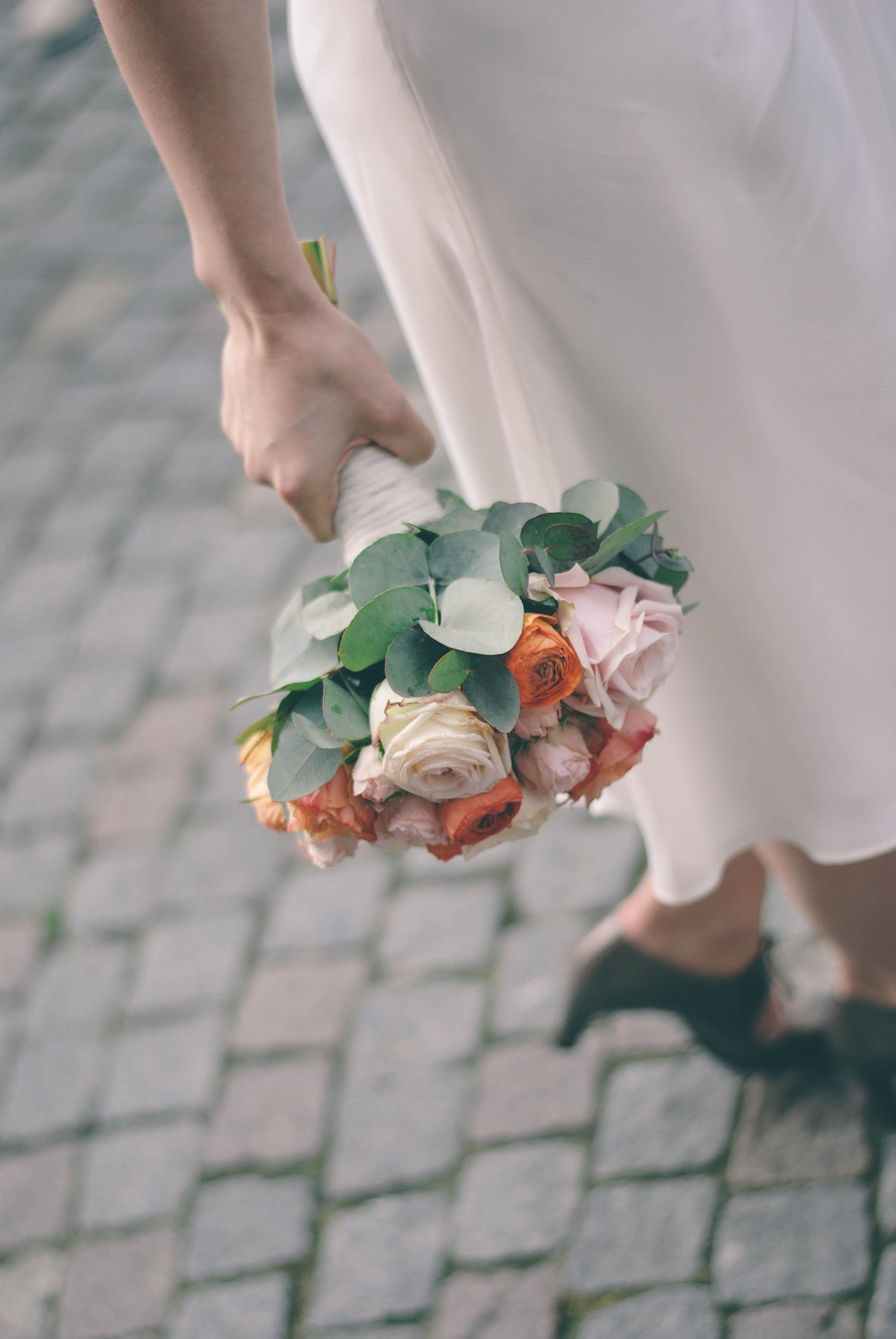 person holding flower arrangement