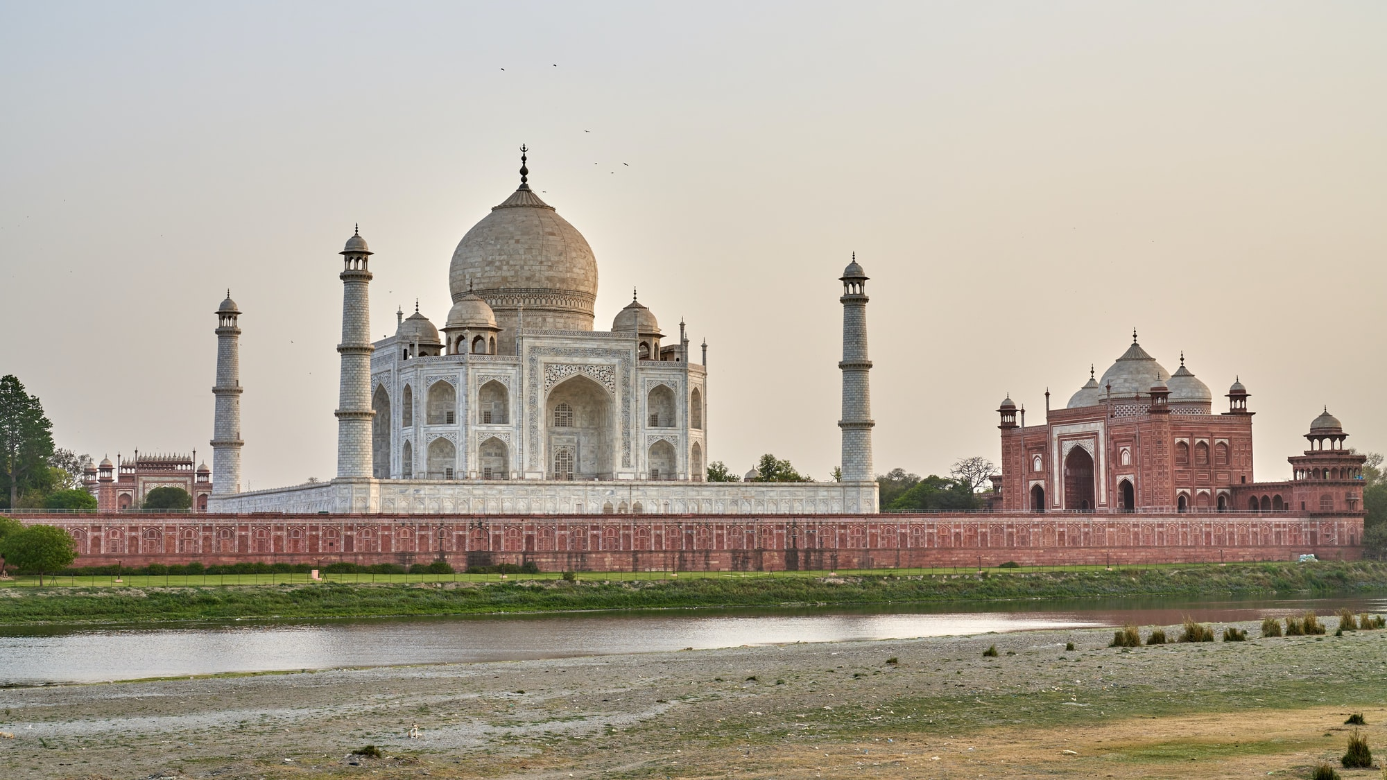 Mehtab Bagh (also as konwn as Moonlight Gardens,) is situated directly opposite of the Taj Mahal on the northern side of the Yamuna River.  The garden has the perfect alignment with the Taj; a lot of people say it is the best view point of Taj Mahal at sunset with a smaller crowd.