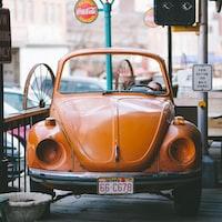 orange Volkswagen beetle car