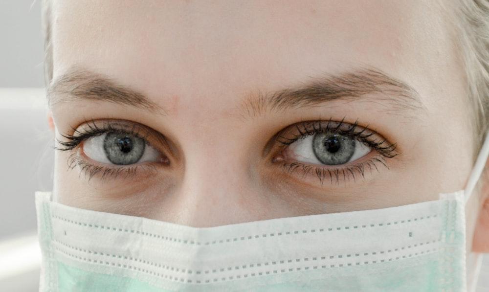 closeup photo of woman's eye wearing mask
