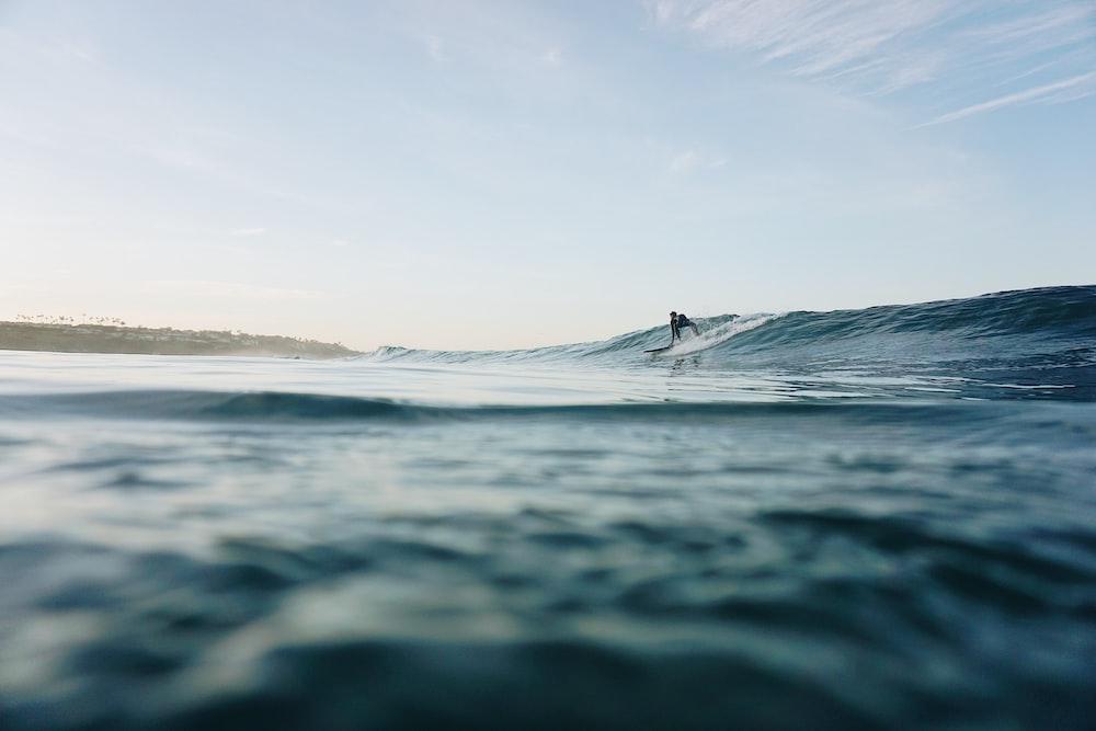 man surfing at sea