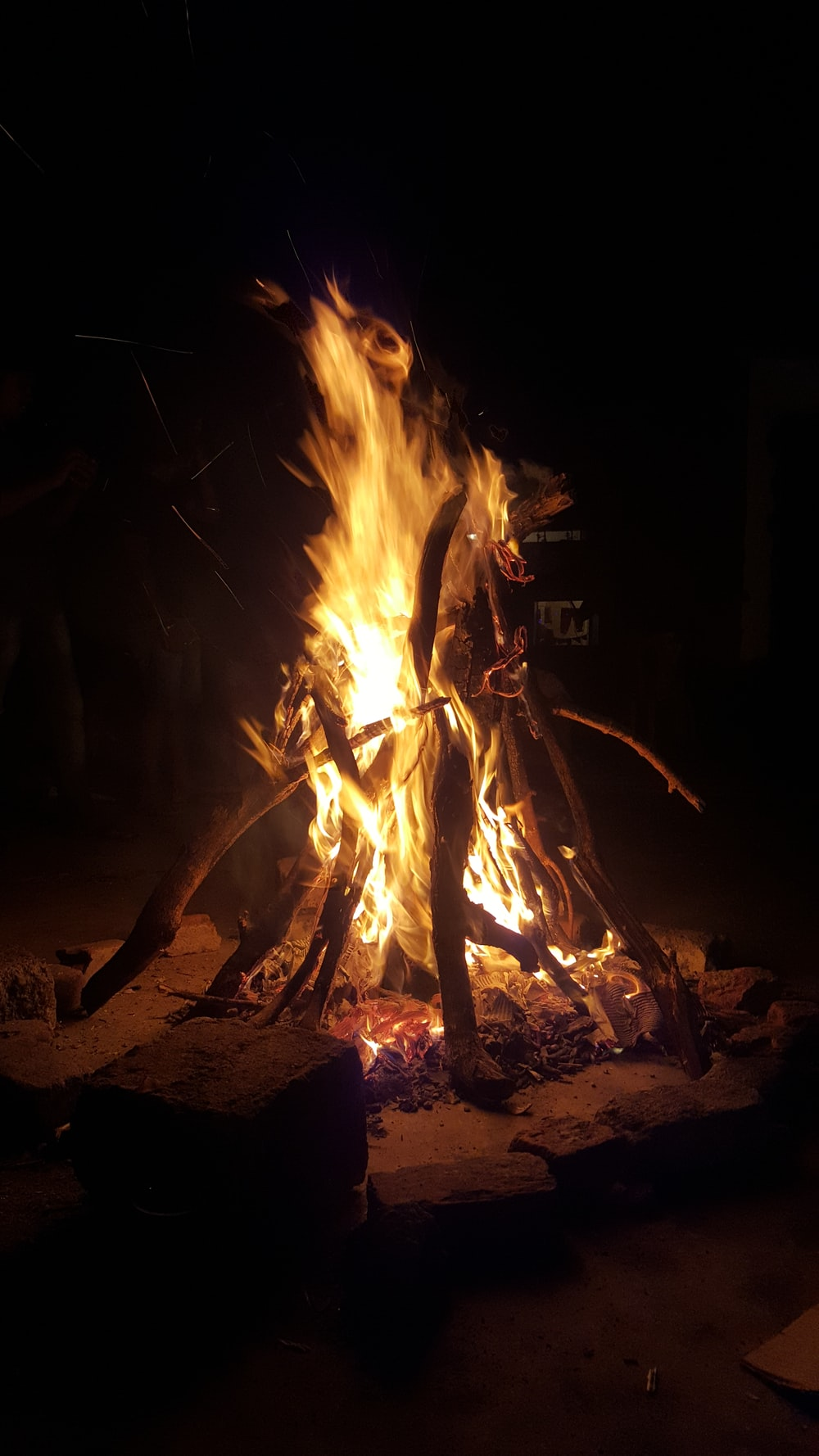 person standing near bonfire