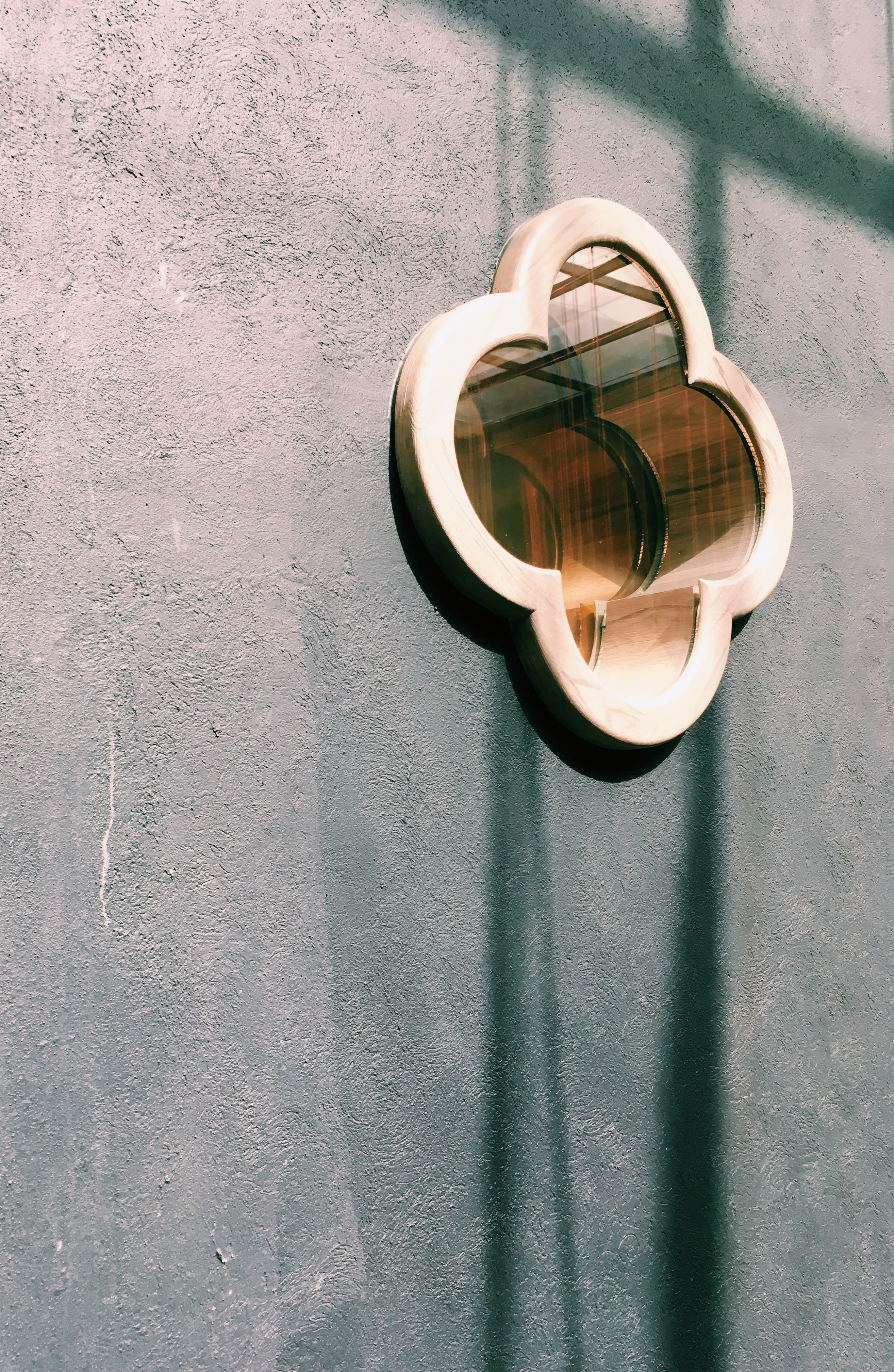 closeup photo of brown wooden framed mirror on wall