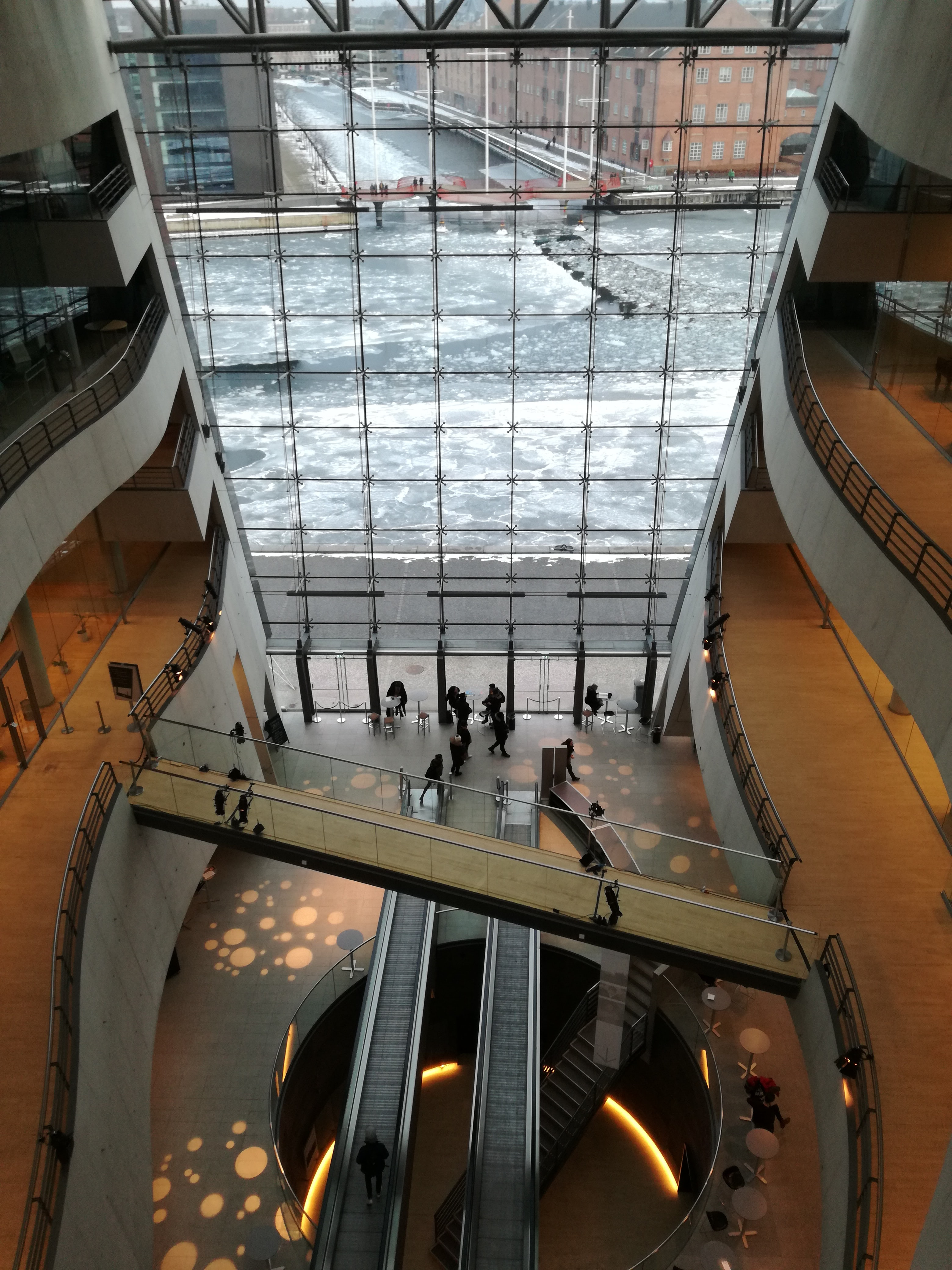high-angle photo of people inside glass building