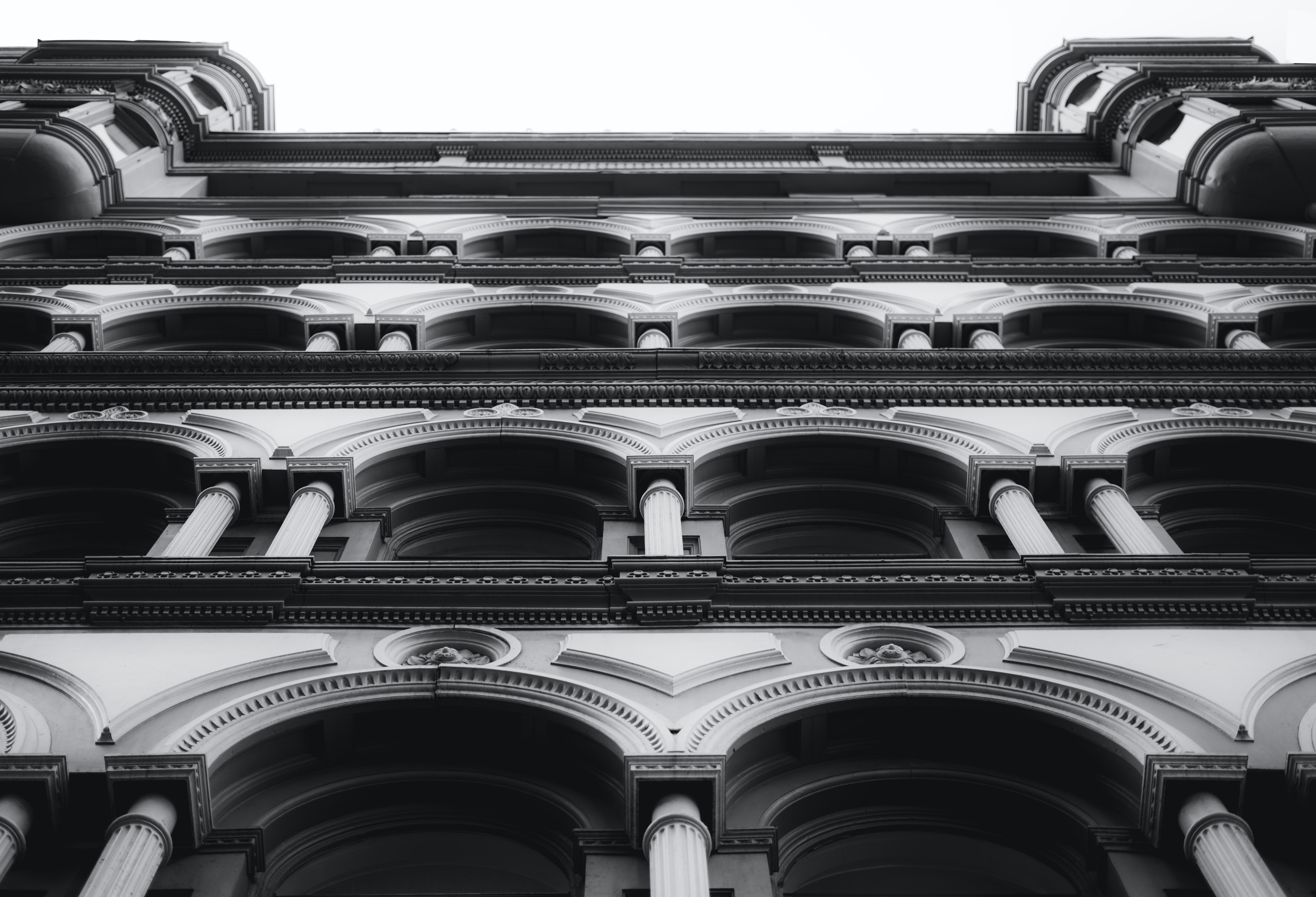 low angle view of baroque building in grayscale photo