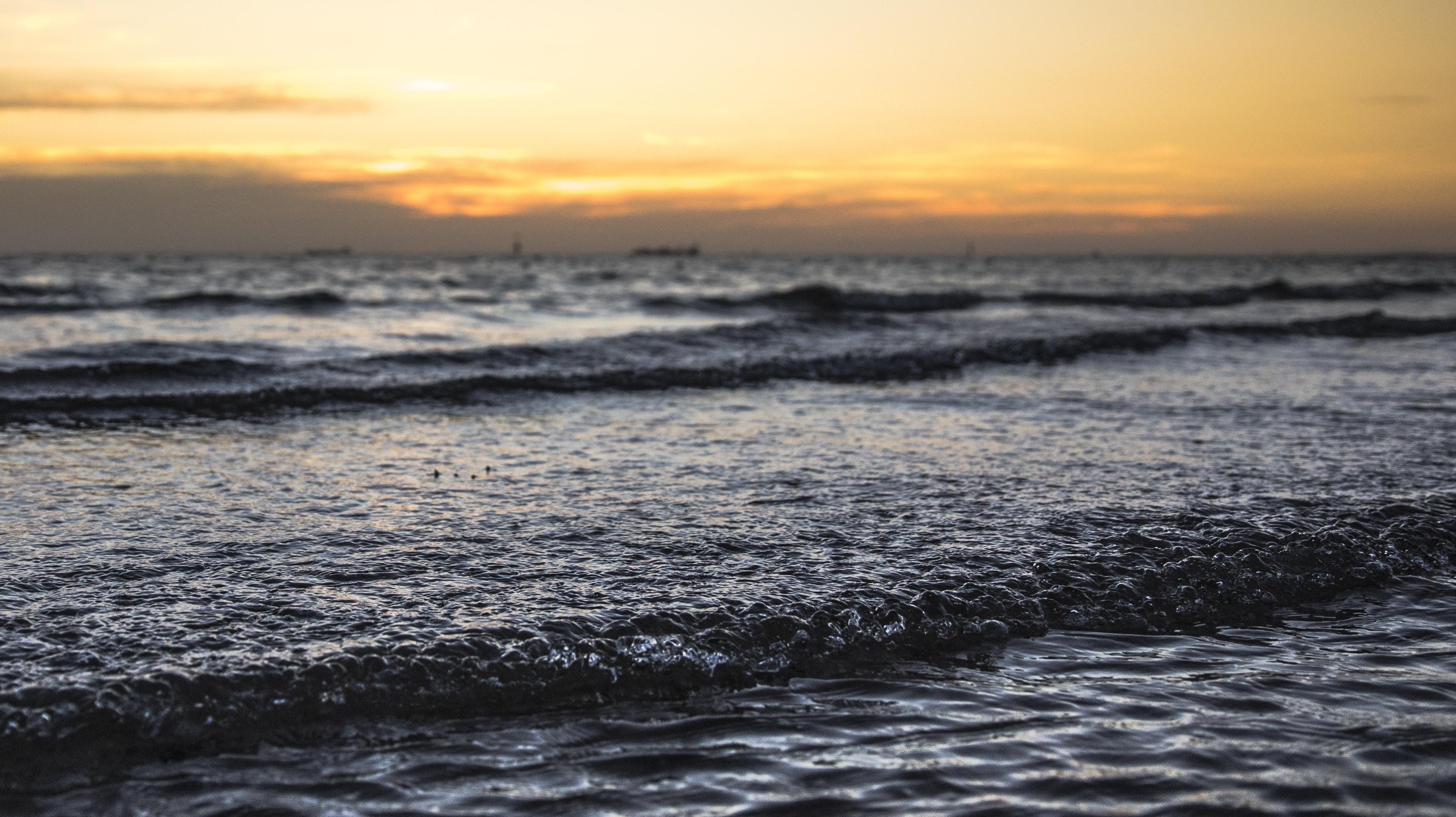 sea wave under sunset
