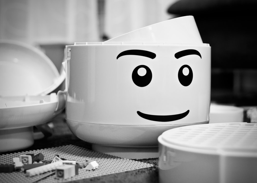 grayscale photography of LEGO piece plastic toy