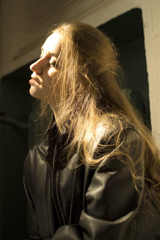 woman wearing black leather zip-up jacket