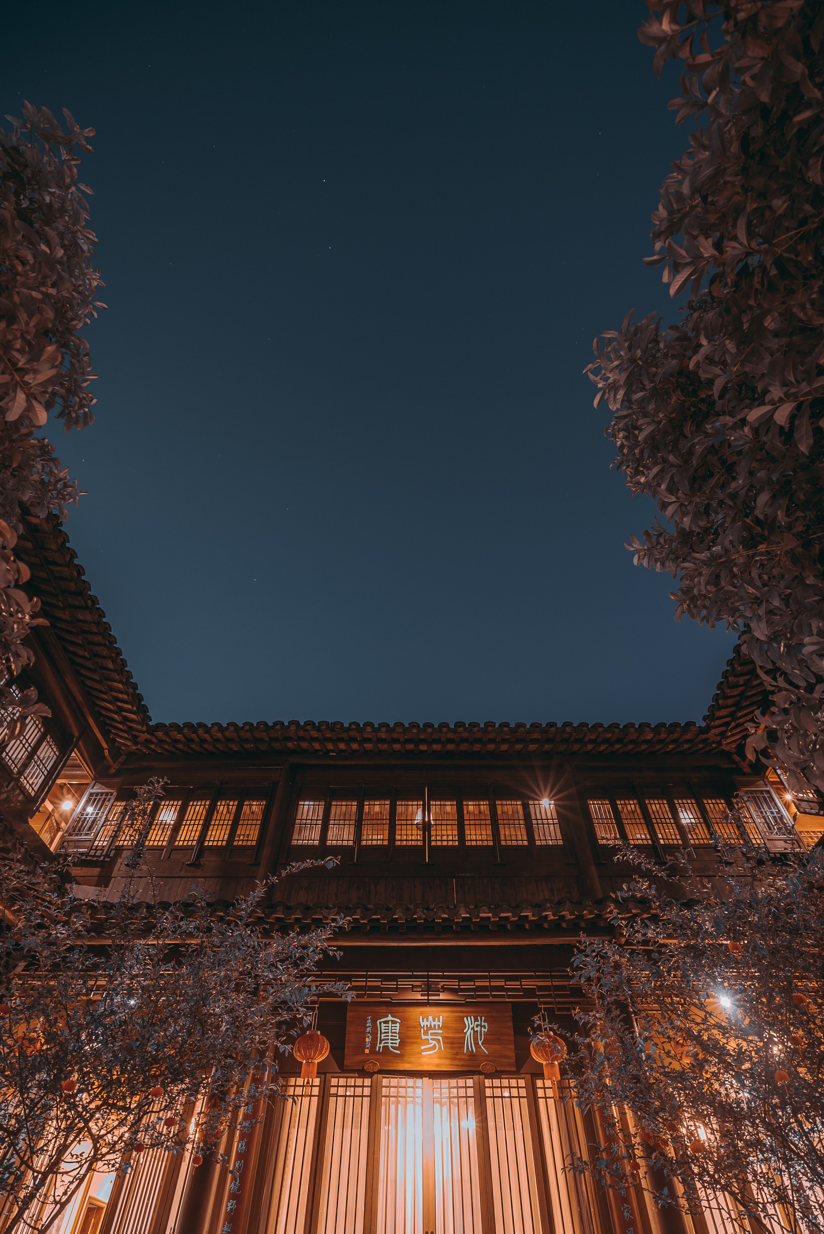 brown wooden temple during nighttime