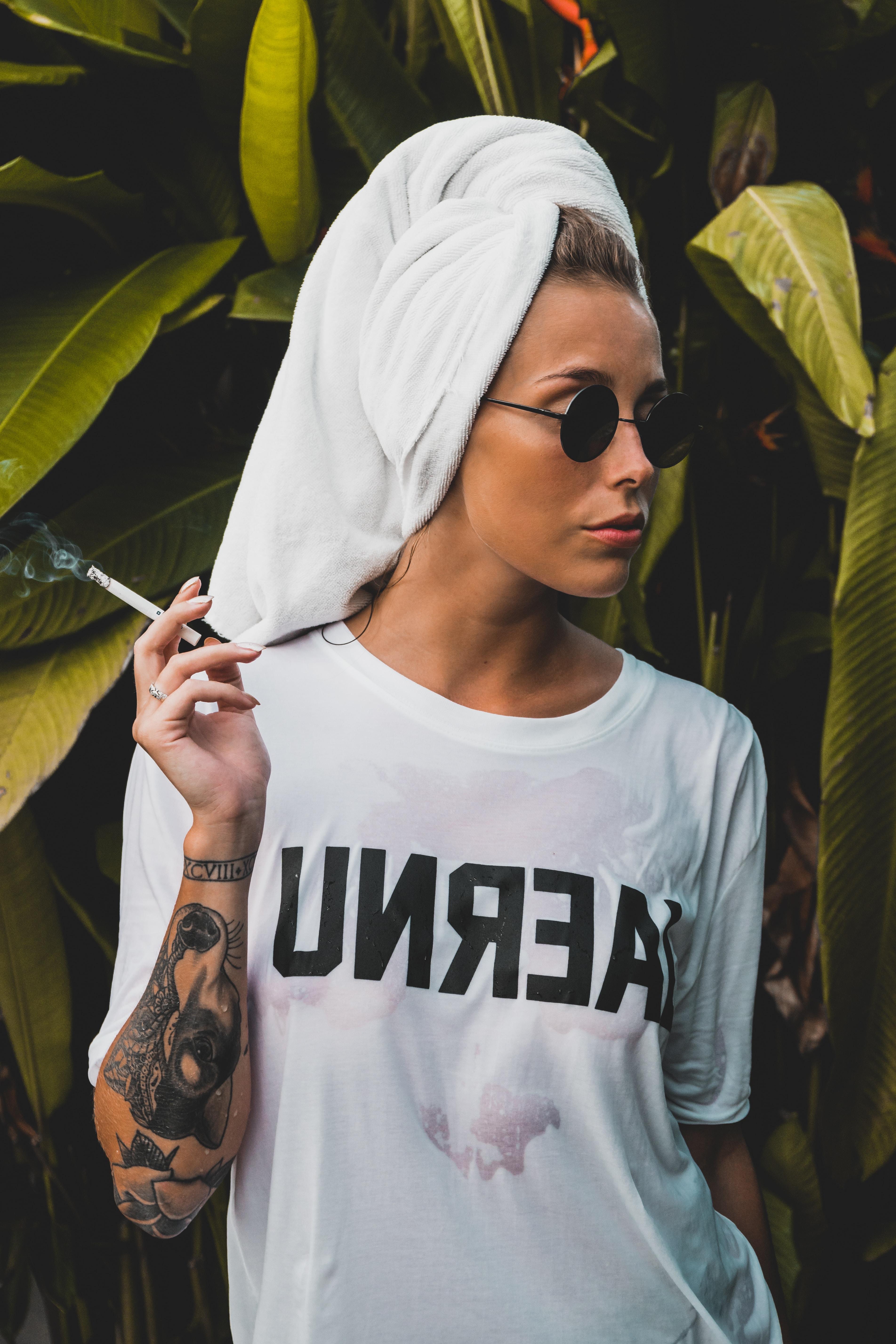 woman holding cigarette stick
