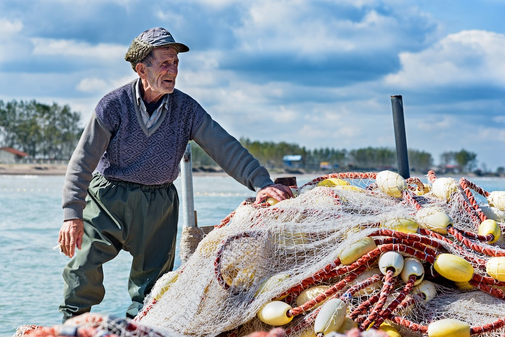 man holding fishing net