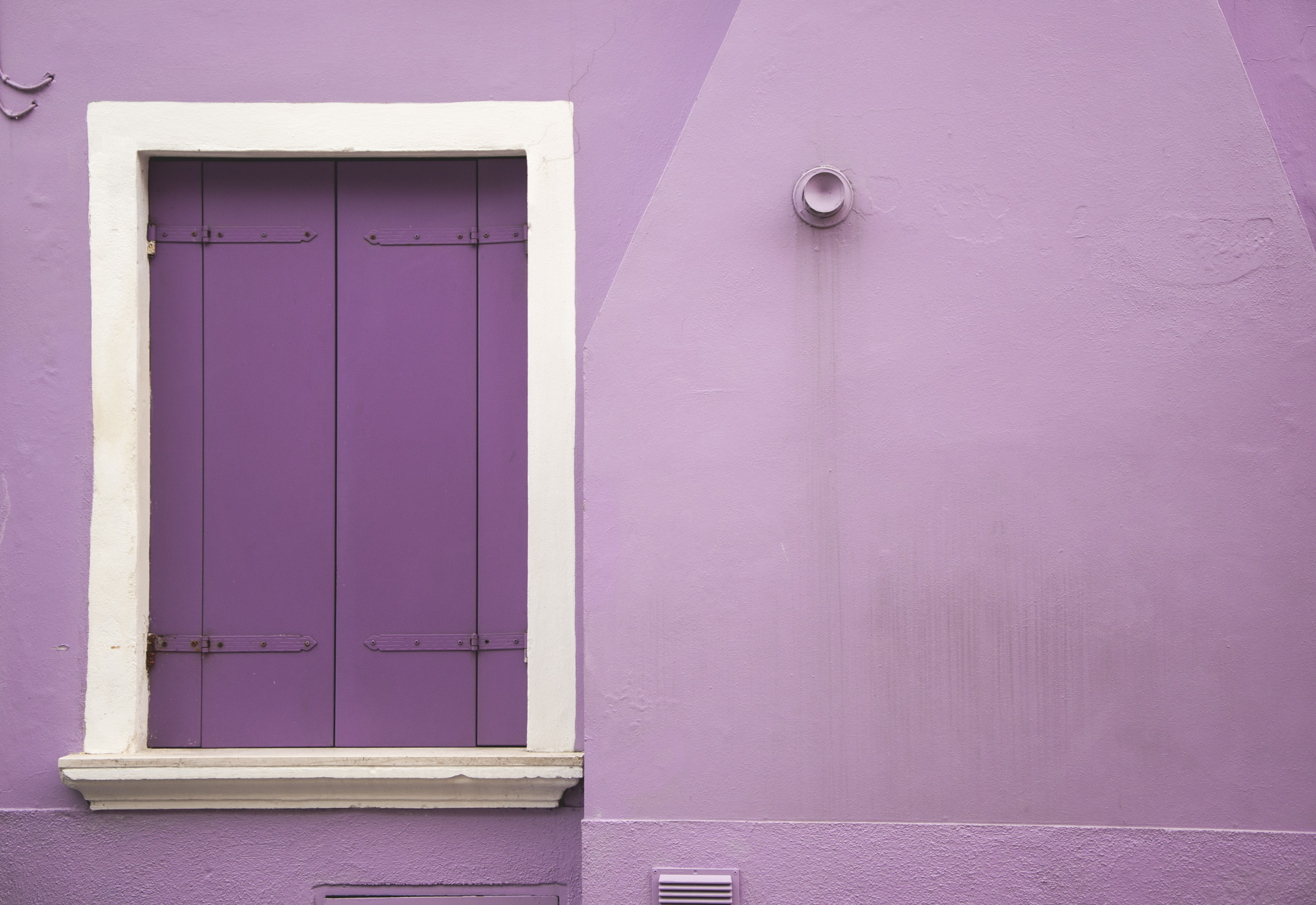 purple wall and white wooden window wall decor