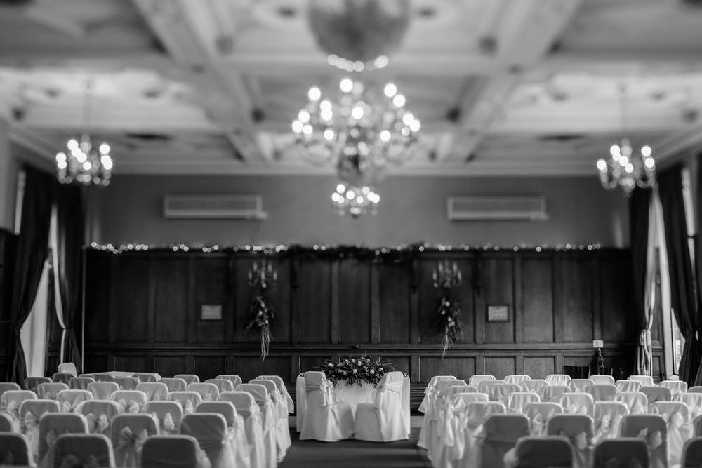 wedding ceremony setup in grayscale photo