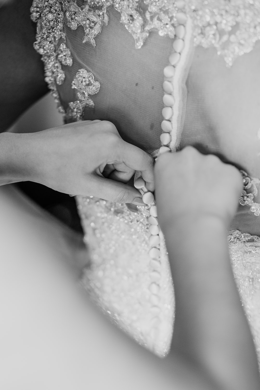 grayscale photo of beaded lace gown