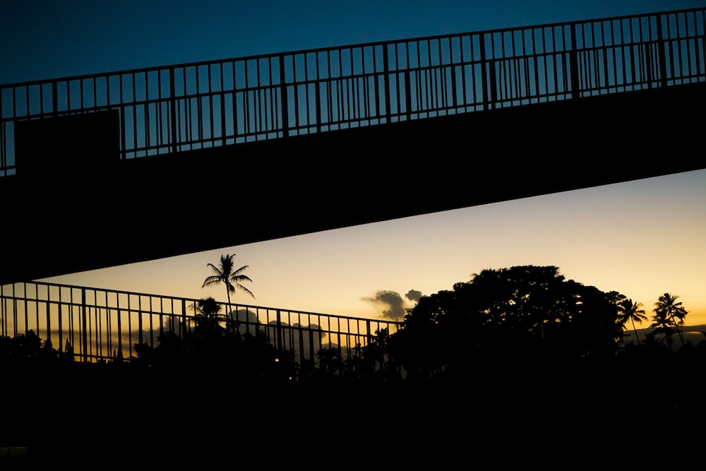 silhouette of bridge during golden hour