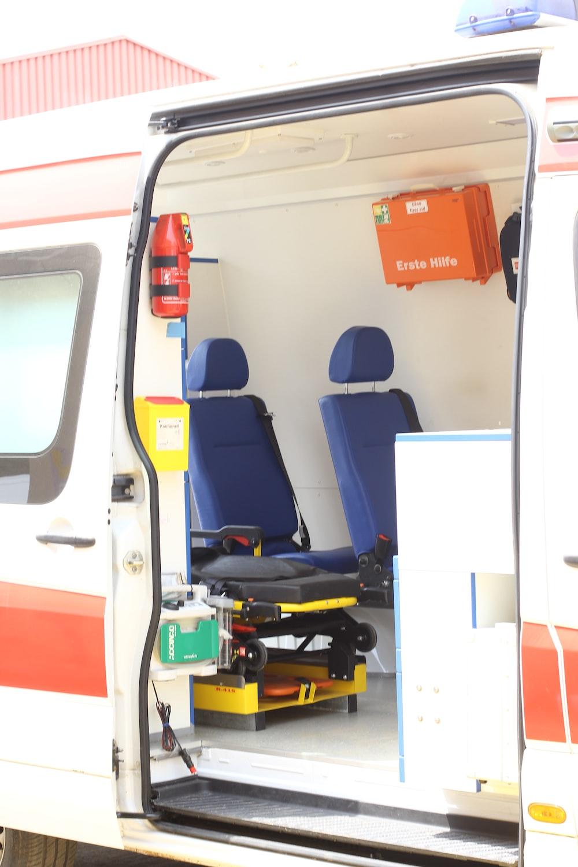opened white and orange travel trailer