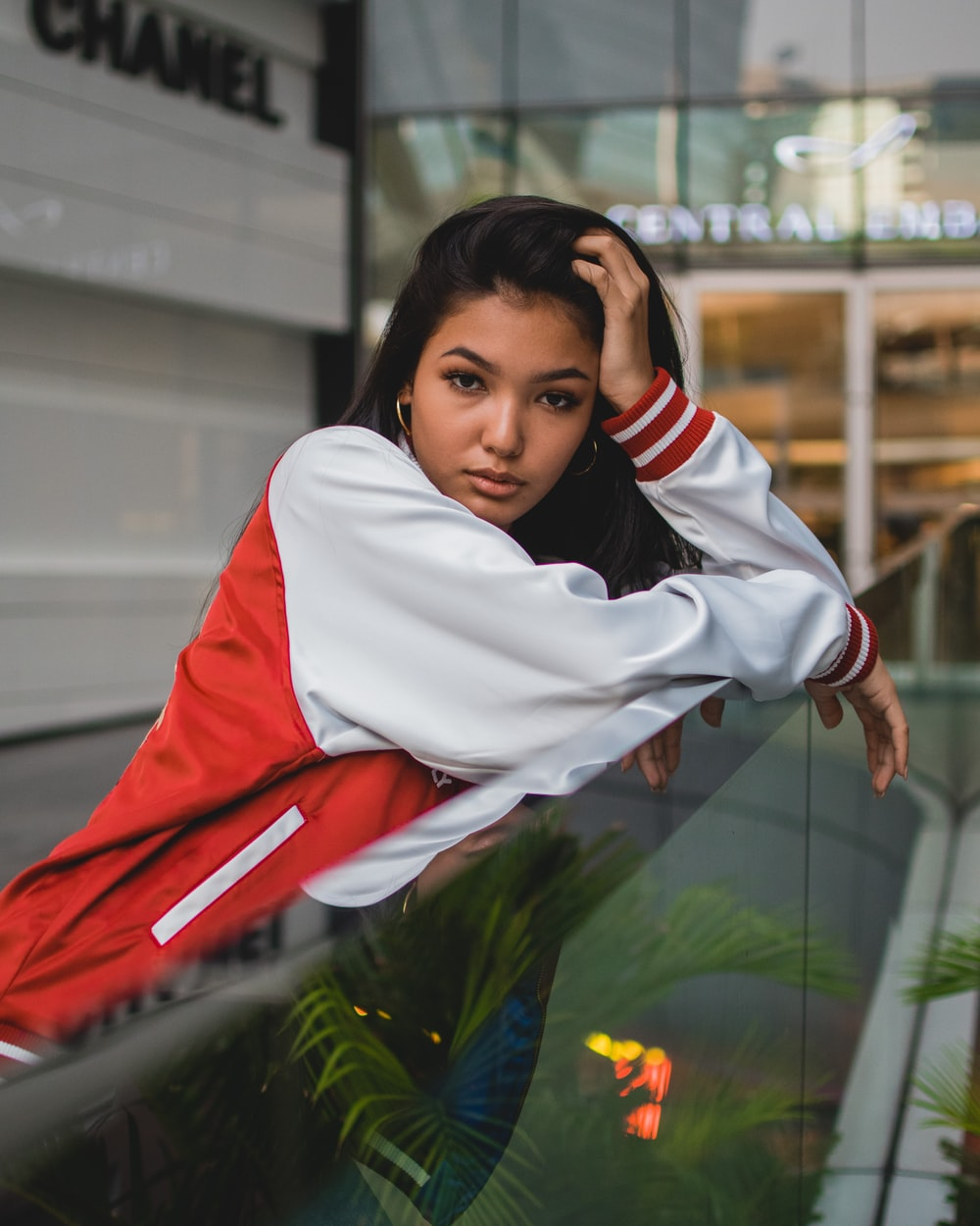 woman on red and white letterman jacket