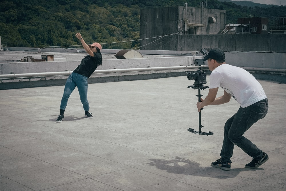 man taking photo to the girl
