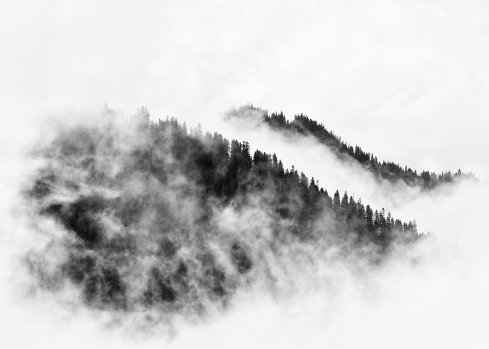 aerial view of fog covered mountain ranges